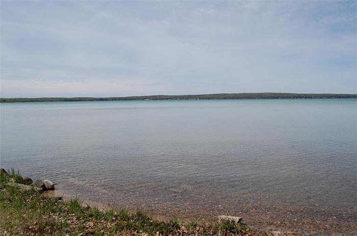 Over 2 acres on Higgins Lake with beautiful well treed parcel.