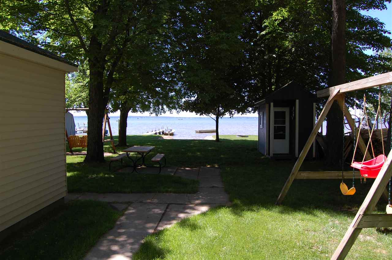 Houghton lakefront homes for sale this winter ken for Lakeside cabins for sale